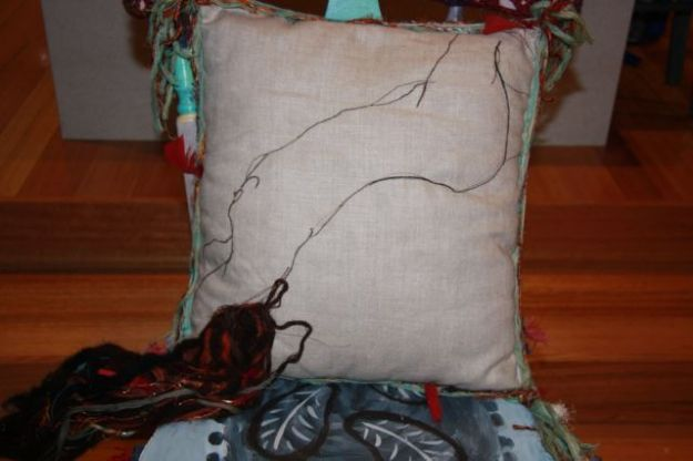 Still something missing. How about a naked lady machine embroidered and felted onto a linen cushion?
