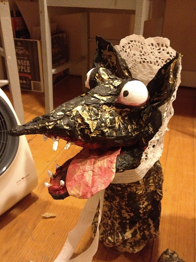 with tongue, painted mouth, bloodshot eyes and Granny's bonnet.