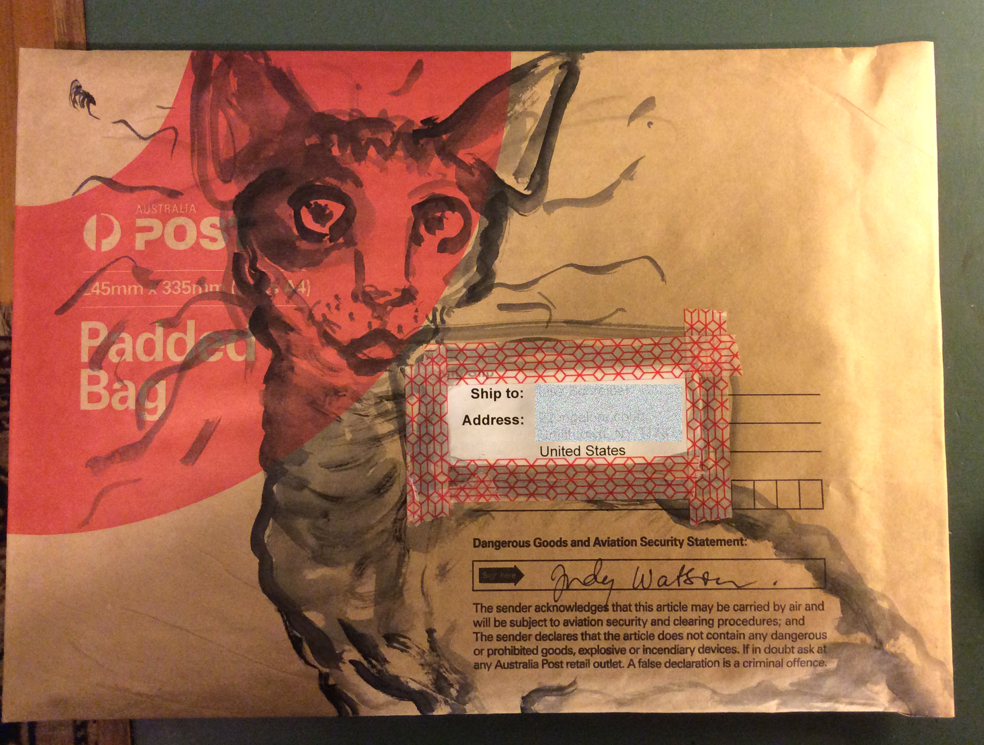 cat parcel awaiting stamps