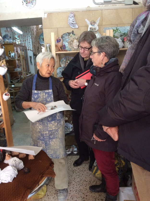 Hiroko wraps treasures adn chats
